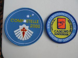 Material badges from Compostelle 2000 and Camino Downunder